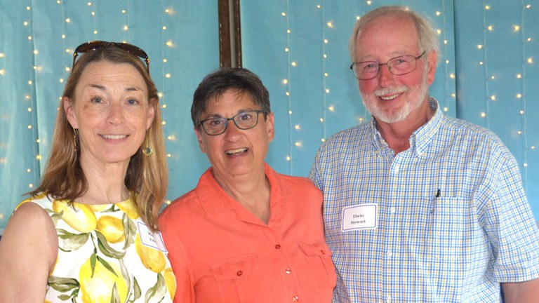 Mary Palm, left, and Elwin Stewart, right, celebrate the retirement of Barbara Christ, former special assistant to the deans in Penn State's College of Agricultural Sciences, center. IMAGE: NANCY WENNER